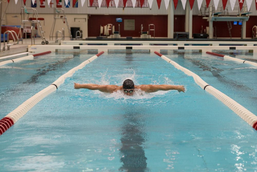 student swimming at the hper pool