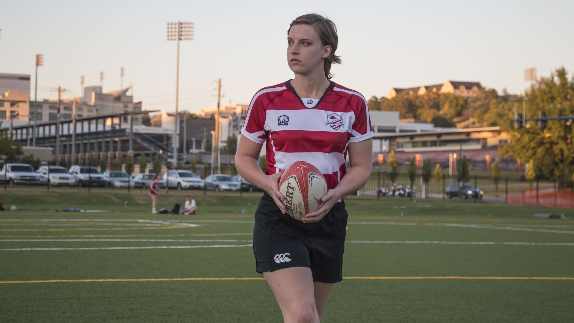 Women's rugby team member holding rugby ball